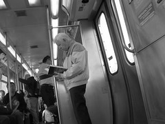 Street Photography (JayKogs) Tags: train reading cta streetphotography oldman chicagometro standingalone elpublictransportation