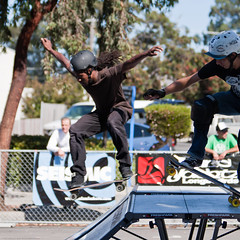 Skateboarders getting some air on a ramp.  Peo...