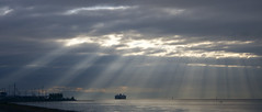 Tsawwassen Cloudscape (Laríssa) Tags: ocean autumn light sea sky canada water ferry clouds grey boat bc britishcolumbia gray tsawwassen pacificnorthwest rays westcoast bcferries sunbeams cloudscapes 2010