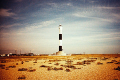 Lighthouse (m+b) Tags: lighthouse beach kent crossprocessed pebbles dungeness vivitarultrawideandslim fujusensia100