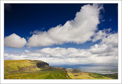 Quiraing (Maciej - landscape.lu) Tags: blue sea sky sun mountains skye rain clouds zeiss landscape geotagged bay scotland spring rocks view isleofskye unitedkingdom sony cottage dramatic alpha 06 paysage hitech gbr sonnar staffin quiraing vario gnd quirrang flodigarry 2470mmf28 a900 eileanacheo alpha900 sal2470za sonydslra900 photographlu variosonnar247028za mlux maciejbmarkiewicz sonyzeissvariosonnar247028ssm landscapelu geo:lat=5761709833 geo:lon=628879500 57°37155n6°171966w gettyimagesbeneluxq1