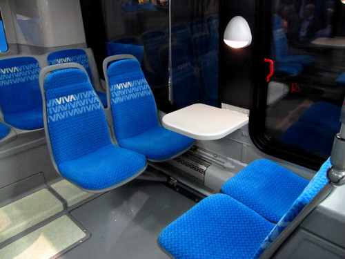 Nova Bus illuminated reading light, small table and facing transit passenger seats, Trans-Expo 2010 Shows Hybrid Diesel-Electric, GPS, Wi-Fi, Solar-Power & H.264 Technologies in Public Transit Buses