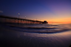 magic color (lensbaby) (Eric 5D Mark III) Tags: ocean california sunset sky people usa cloud blur color beach silhouette lensbaby canon pier twilight unitedstates wave atmosphere newportbeach orangecounty tone composer eos5dmarkii doubleglassoptic 042xsuperwideangleconversionlens