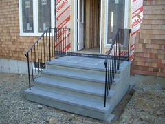 2. Stone tread (bluestone), stucco finish and rails