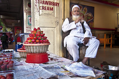 Strawberry and Cream - Portrait of a Strawberry Seller in Panchagani (Anoop Negi) Tags: red vacation portrait india holiday station festival fruit beard photography for photo strawberry media holidays image photos delhi indian hill bangalore cre