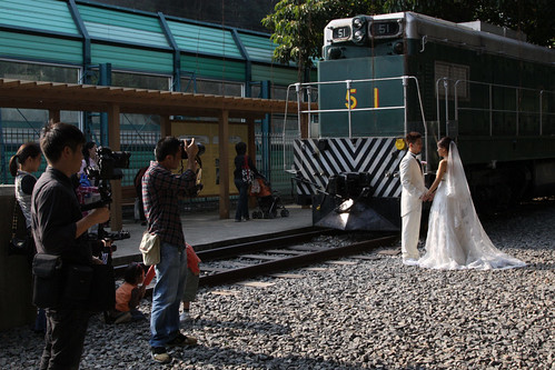 Doesn't every little girl want their wedding photo to be in front of an EMD G12 diesel-electric locomotive?