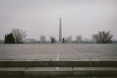 North Korea (weiskom) Tags: northkorea pyongyang people leica street bicycles juche tower