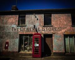 Back in Time (Explore) (Rae de Galles) Tags: building buildings blueskies pink old blue coast seaside crumbling mail red postbox cymru wales history past shop store