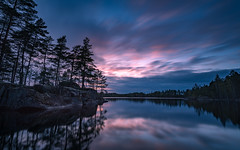 Forest lake dusk (jarnasen) Tags: nikon d810 nikkor 1635mmf4 wideangle tripod longexposure le leefilters ndfilter nd10 sky reflections clouds movingclouds dusk evening bluehour forest rocks trees water lake ngryten norragryten östergötland sweden sverige geo geotag copyright järnåsen jarnasen rimforsa nordiclandscape landskap landscape lakescape light scandinavia sunset nature mood atmosphere gallery smooth view scenery outdoor explore explored