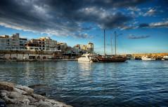 Nubes y claros (candi...) Tags: mar puerto velero cielo nubes agua lametllademar catamarán barcos rocas pueblo casas airelibre sonya77