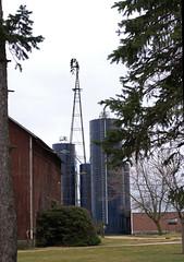 really tall one (WORLDS APART PHOTO) Tags: dekalb dekalbillinois windmillwednesday windmills illinois outdoors farming farmyard silos barn agriculture tall high