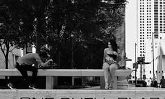 Getting The Angle (burnt dirt) Tags: houston texas downtown city town mainstreet street sidewalk corner crosswalk streetphotography fujifilm xt1 bw blackandwhite girl man woman people person couple pair group crowd walking talking standing looking boots heels stilettos sandals model photographer camera lens dress skirt shorts glasses sunglasses purse bag phone cellphone pose longhair shorthair ponytail kneehigh blonde brunette headphones cap hat asian friends bike bicycle prom lovers