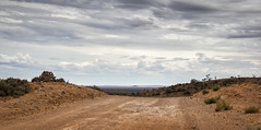 Over the rise (Ralph Green) Tags: australia brokenhill newsouthwales silverton clouds dirtroad hill landscape road scrub trees