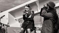 in transit (Gerard Koopen) Tags: nederland netherlands amsterdam capital city ferry ndsmwarf people woman women mobile binoculars bw blackandwhite candid straatfotografie streetphotography fujifilm fuji x100t 2017 gerardkoopen