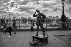 Salute (cuppyuppycake) Tags: black white bnw london uk england southbank south bank thames river tourist street performer