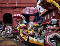 trishaws galore (SM Tham) Tags: asia southeastasia malaysia malacca melaka unescoworldheritagesite dutchsquare redsquare christchurch trishaws umbrellas artificialflowers canopies hearts toys dolls flags red buildings tinsel decorations