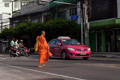The monk, a pink taxi and triple riding scooter, that's Bangkok! (Scalino) Tags: thailand bangkok pinkcab pink taxi monk saffran orange dress tripleriding scooter