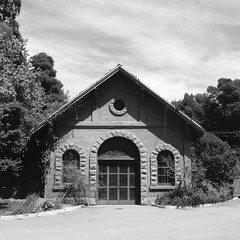 The Old Stables (melystu) Tags: architecture symmetrical building arched stone brick painted stables support transport working mountainview cemetery park oakland victorian landscape blackandwhite california history gable