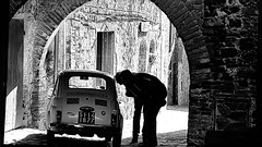 Admiring Looks. (ManOfYorkshire) Tags: fiat small car auto automobile archway arch stone local building tsucany italy bw blackwhite men looking admiring wishing si141877 lhd leftrhanddrive