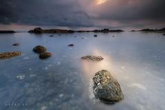 OUT OF TOUCH (jopetsy) Tags: sual pangasinan sunrise sunset seascape landscape fujifilm fuji philippines rain rock stones pebbles