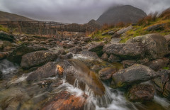 Everything will flow... (Lee~Harris) Tags: landscape outdoor water flowingwater mountain colour rugged river stream rocks beauty ogwenvalley ngc nikon d300 nature mothernature serene tranquil love happy light cloud storm april motion landscapes wales cymru
