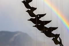 L'arc en ciel et les oiseaux en céramique (The rainbow and the ceramic birds) (Larch) Tags: mobile oiseau bird arcenciel rainbow ciel sky montagne mountain alps alpes soir evening contrejour backlit céramique artisanat crafts ceramic