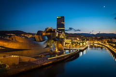 Bilbao at Night (Anthony's Photo Collection) Tags: museum guggenheim spain bilbao riverfront river night longexposure nightlights sunset architecture europe cityscapes basque basquecountry paysbasque