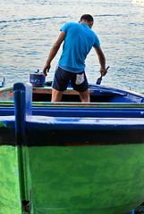 [ Una mano di mare - A layer of sea ] DSC_0228.2.jinkoll (jinkoll) Tags: street people guy boy man boat painting varnish blue green scilla calabria scylla sea bokeh dof acting waves