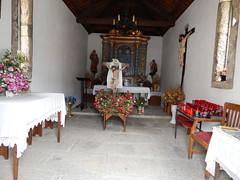 Ermita Divino Cristo (amgirl) Tags: ermita ermitadivinocristo elbierzo spain fuentesnueves april19 day21 caminodesantiago caminofrances candles altar locked flowers window