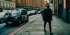 Walking about the streets of London #1 (stray_light_rays) Tags: london streetphotography street candid uk unitedkingdom ninja daytime strangers onepersononly photography walking passingby shades glasses beard headphones taxi cab pavement cinematic