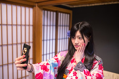 Young woman in Kimono taking selfie picture in Japanese tatami room (Apricot Cafe) Tags: img26636 2024years asia asianandindianethnicities ishikawaprefecture japan japaneseethnicity japaneseculture kanazawa kimono sigma35mmf14dghsmart architecture charming cheerful citylife day enjoyment fashion freedom freshness hairaccessory happiness horizontal indoors lifestyles longhair oldfashioned oneperson onlywomen photographing photography posing relaxation selfie shoji smartphone smiling springtime tourism traditionalclothing tranquility travel traveldestinations waistup weekendactivities women youngadult