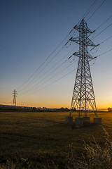Electric Sunset (Victor Lasheras Photography) Tags: high voltage alto voltaje torre tower sunset atardecer country side campo prado orange blue azul naranja hierba grass steel sky