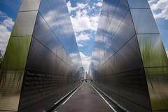 memorial (primemundo) Tags: frame flickrfriday memorial jerseycity nyc reflections lines leadinglines clouds sky 911 september11