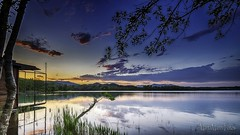 Clouds... (martamanni fotos) Tags: clouds lake reflections water colors trees sky