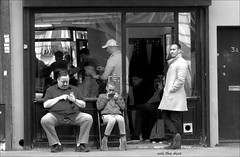 `1965 (roll the dice) Tags: london camden nw1 morningtoncrescent charlies blackandwhite streetphotography cut haircut skinhead razor queue scissors boy busy lunch hours mirror people natural mad sad funny surreal londonist tourism canon england uk art classic urban unaware unknown portrait copy strangers candid phone mobile tex talk communication shadows barbers style shave groom outside open fashion shops shopping community cap glass window reflection traffic