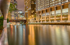 Blurred Boat (tquist24) Tags: chicago chicagoriver chicagoriverwalk hdr illinois nikon nikond5300 trumptower wabashavenuebridge boat bridge city cityscape fence geotagged lighttrails lights longexposure night reflection reflections river water unitedstates
