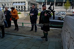 Some of the attendees and James the bagpiper (James O'Hanlon) Tags: international workers memorial day internationalworkersmemorialday service liverpool 2017 malcolmkennedy deputy mayor cllr malcolm kennedy wreath public pier head georges dock mersey tunnel