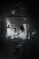 Photo artistry - Trapped (mcleod.robbie) Tags: trapped black white tenture tone scary scare furnancefashionedphotography doom dream nightmare alone woman girl bottle