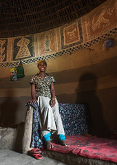 Ethiopian woman inside her traditional painted and decorated house, Kembata, Alaba Kuito, Ethiopia (Eric Lafforgue) Tags: abyssinia adult africa alaba architecture art bed building circular color culture decorated decoration depiction eastafrica ethiopia ethnic fulllenght geometric halaba home hornofafrica house hut illustration indoors islam kulito mural muslim oneperson onewomanonly painted painting poverty residential round ruralscene toukoul traditional tukul vertical village woman women ethio163452 alabakuito kembata