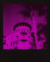 Magenta Castle Green (tobysx70) Tags: the impossible project tip polaroid slr680 frankenroid sx70 door rollers red black blackandred duochrome film for 600 type cameras instant blackframe impossaroid magenta castle green raymond avenue pasadena california ca pink hotel apartments condo condominium 1893 1898 route 66 rt rte palm tree tower digitally manipulated toby hancock photography
