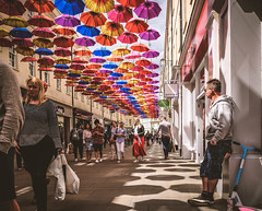 In the shadows (phil anker) Tags: street bath light shadow umbrella fujix70 photingo