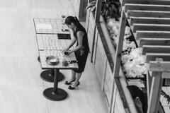 Preparations (jack .b.) Tags: nikond810 sigmaart13518dg blackandwhite candid street ciracenter table perspective woman dof philadelphia philly 2017 urban