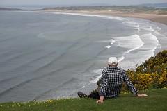 slippery slope (quietpurplehaze07) Tags: cliff ray husband slipperyslope gorse yellow waves sea sky buttercups rhossilibay