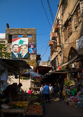 Hariri family posters at the entrance of the old souk, North Governorate, Tripoli, Lebanon (Eric Lafforgue) Tags: architectural architecture assassinated banner building buildings colorimage coveredmarkets fruits groupofpeople hariri lebanese lebanon liban liban068 market markets memorial middleeast minister political politics poster prime propaganda rafic rafiq souk souks stalls street town trabulus trade tripoli vegetables vertical northgovernorate lb libanon libano ливан レバノン لبنان