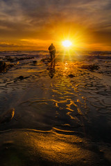 And he shoots into the setting of the sun. (EricGail_AdventureInFineArtPhotography) Tags: sunset lajolla beach potholes canon