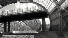 Bisected glass tunnel (posterboy2007) Tags: glass tunnel bw monochrome sony architecture soundbarrier
