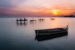 Barca solitaria (SDB79) Tags: barca alba pesca lago sole luce lesina natura