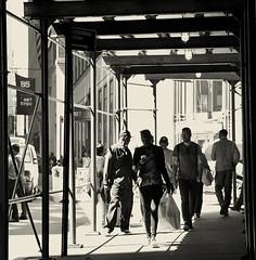 Lunchtime Street, Near My Office (sq. crop) (sjnnyny) Tags: pentaxkp sigma1770f284dcmacro nyc johnstreet people officeworkers pedestrians sjnnyny stevenj sidwalkshed midday lunchhour lowermanhattan nylife tonedmono sidewalk traffic
