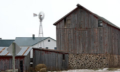 old and the new (WORLDS APART PHOTO) Tags: amish barn stonework rustic rural rusticrural windmillwednesday windmills kingston kingstonwi wisconsin plain winter outdoors fieldstone roof