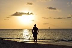 Tramonto caraibico (Tommy Terziotti) Tags: sands siloulette beach sole cocobay antigua sea boat barca sun girl silouette spiaggia mare caraibi tramonto sunset